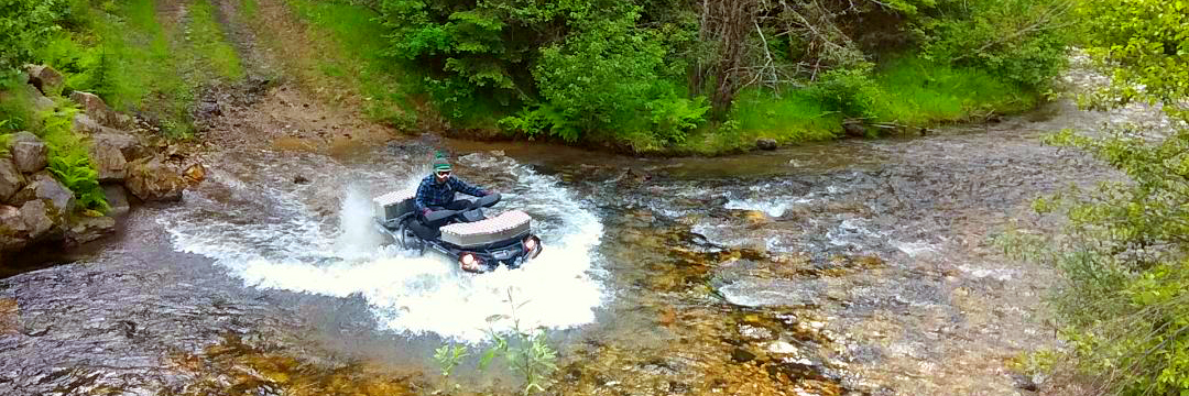 atv-in-river-slider